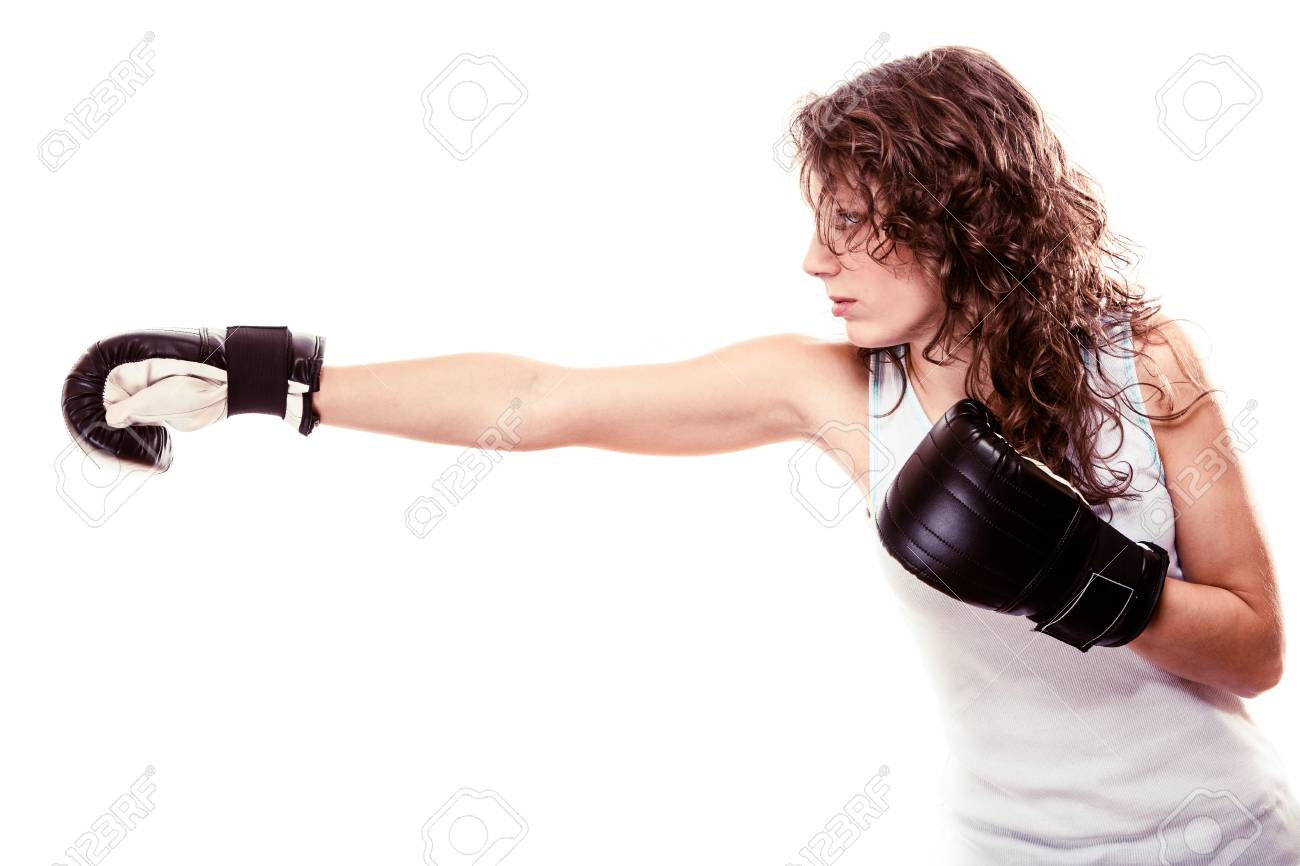 Sport boxer woman in black gloves. Fitness girl training kick boxing.